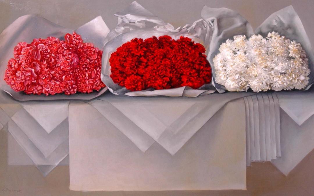 Oeillets rouges, blancs et roses